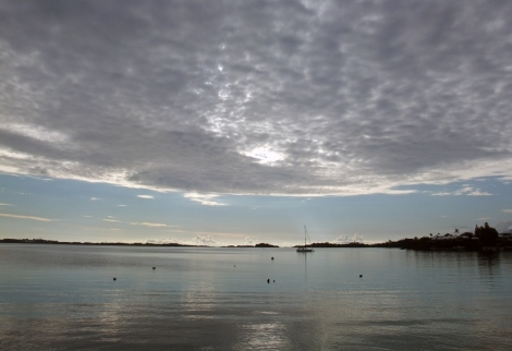 Mackerel skies over the dive site, a sign of oncoming storms. - © 2012 Warwick Project