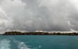 A storm on the horizon. A panoramic view of the site, taken as we leave quickly, hoping to avoid being caught in rough seas. - © 2012 Warwick Project